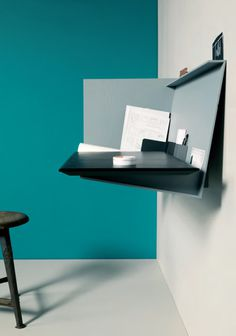 Desk Pad is a minimalist design created by Germany based designer Eric Degenhardt. Desk Pad is a wall mounted bureau with a retractable desk #desk