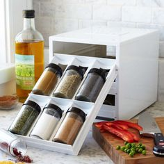 Easily access and compactly store up to 18 containers of spice. #design #product #lifestyle