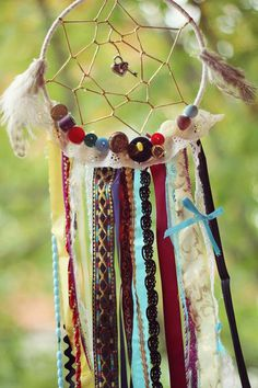 For a more personal touch, add some of your stuff in your dream catcher like your pendant, some buttons you had over the years, rosary beads