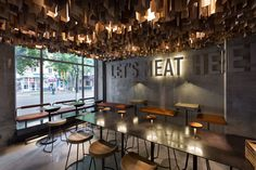 Shade Burger YOD studio interior design mindsparkle mag concrete wall ceiling hanging wood industrial modern typography sign type design
