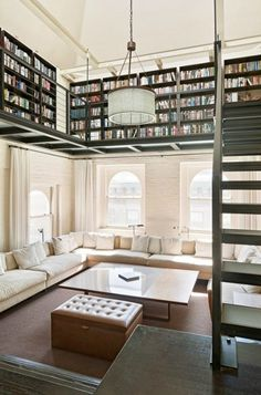 dyingofcute:Tribeca, New York Duplex with plenty of book space #living room #library