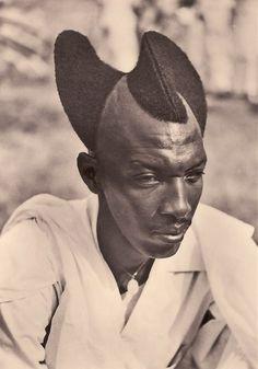 Rwandan man with Amasunzu hairstyle, 1923