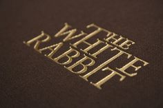 The White Rabbit #embossed #wordmark #texture #typeography #gold #rabbit #foil
