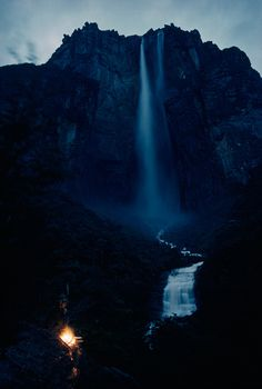Roaring out of Auyan-Tepui's wall, a waterfall plummets over 3,000 feet in Venezuela, March 1963. Photograph by Thomas J. Abercrombie, Nat #mountain #water #height #exploration #landscape #night #photography #vintage #glow #national #jungle