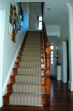 Victorian style wooden staircase in stained wood with carpet runner and carpet rod #staircase #wooden #runner #carpetrunner #rods #carpetrod