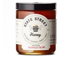 State Street Honey Package Design. 60lb Neenah Estate #9 Laid Cream Label Paper. Black ink and Gold Foil Stamp. Designed by Jess Glebe Desig