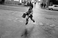 Josef Koudelka. 'Lisbon, Portugal' 1975 #photography #black and white #child #jump #prance #skip #work #road #street #blur #infant #boy