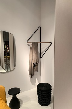 This Clothing Rack Was Designed To Fit Into Corners