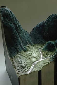 Carved Book Landscapes by Guy Laramee #sculpture #books #art #recycled #mountains #hills