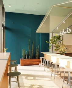 Shining Metal Bar at Seesaw Coffee by NOTA Architects - InteriorZine