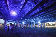 Recycled Bike Part Chandeliers Under a Texas Overpass #chandelier #color #light #purple