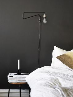 Wood, white and black in a warm mix emmas designblogg #lamp #pillow #light #bed #table