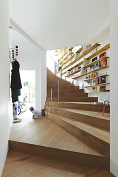 The Black Workshop #staircase #hooks #bookshelf