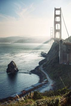 The Shadow of the Bridge by James #us #sun #sky #san #road #travel #nature #mood #sunrise #francisco #bridge #mountains #waves #backlight