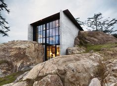 Glass windows, snug into landscape #cement #architecture #house #contemporary