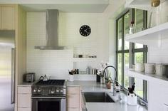 Kitchen, Wood Cabinet, Engineered Quartz Counter, Concrete Floor, Range, Ceramic Tile Backsplashe, and Refrigerator Upcountry Maui Cottage and Barn: kitchen Photo 87 of 2509 in Best Kitchen Photos from Haiku Maui