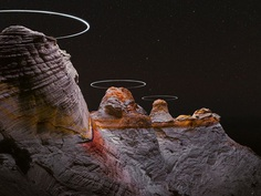 Long Exposure Photos Capture the Light Paths of Drones Above Mountainous Landscapes | Colossal