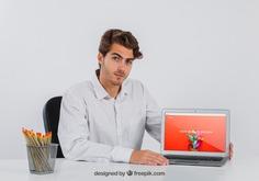 Businessman at desk with laptop Free Psd. See more inspiration related to Mockup, Business, Technology, Computer, Template, Fashion, Man, Laptop, Presentation, 3d, Elegant, Corporate, Businessman, Mock up, Desk, Business man, Modern, Branding, Pc, Psd, Minimal, Professional, Mockups, Sitting, Up, Set, Realistic, Showcase, Stylish, Mock, 3d mockup, Minimalistic, Psd mockup and Realism on Freepik.
