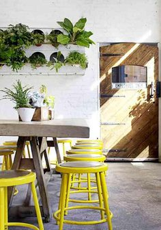 Yellow industrial stool: Remodelista #interior #wood #yellow #plants