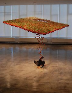 Fluid Art Installation, Created with strawberries, taxidermied crow, fishing hooks, nylon, and was exhibited at Building With Colour, Galler
