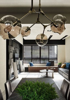 Taichung Apartment Featuring Dark Hues and an Elegant Material Palette 3