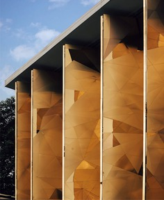 Mantab Workplace Gleaming with Gold-Copper Facade - InteriorZine