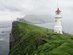 The lighthouse at the western point of Mykines island, Faroe Islands