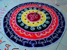 Rangoli Designs with Lamps and Colours