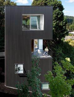 Modern Vertical House Accessed by a Steel Pedestrian Bridge 1