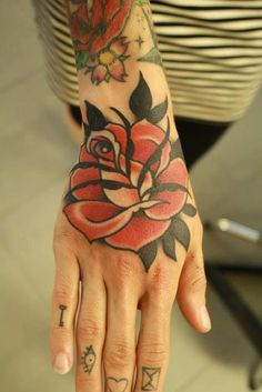 fuckyeahhandtattoos:Chriss Dettmer #rose #tattoo #hand #icons