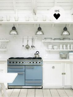 white kitchen with blue stove | the style files #interior #kitchen #white