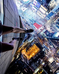 Daredevil Building Climber: Roooftop Photography by Andrej Ciesielski