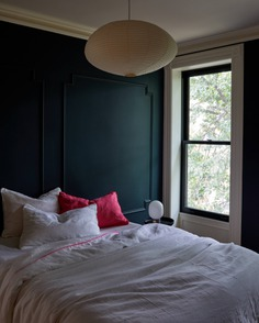 Noguchi lights are arresting enough to hold center court in public spaces—yet understated and intimate enough for bedrooms, like this one. Photograph by Kate Sears; styling by Kate S. Jordan, from The Sentimental Minimalist: A Young Architect's Bed-Stuy Townhouse Makeover.