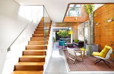 Colourful and Open Family Home by Elaine Richardson Architects symbolic inner courtyard skylights