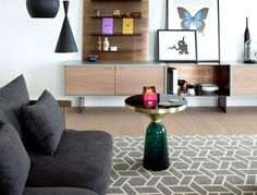 Luxury Penthouse Designed by Amos and Amos living area geometric rug flanked two sofas