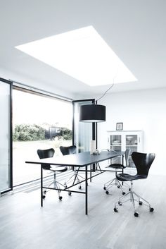 Dining area with skylight. Bang House by Norm.Architects. #normarchitects #diningroom