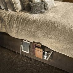 The Bed Butler is an organizer for things you'd like to access from your bed.