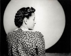 Portrait of woman in profile modeling a hairstyle, in Harris Studio