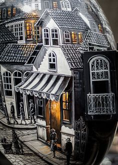 Close look of creative phone booth painted like small town inside #phone #public #booth #art #street #exterior #telephone