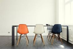 4 Eames chairs in a stark room #design #architecture #eames