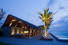 Beach bar in a tropical green resort complex