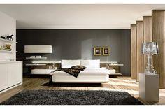 Small paintings in minimalist bedroom