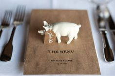 Spray paint plastic animal figures and use as place cards. #menu #pig #food
