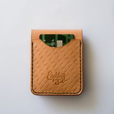 Hand-stamped leather wallet by Eighteen32. #handmade #leather #wallet #billfold #logo #design