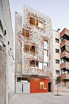 A Facade Of Colorful Ceramic Blocks Cover This Apartment Building #inspiration #apartment #colorful #architecture