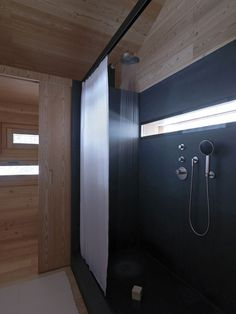 cozy-mountain-cabin-can-open-to-elements-8-bathroom.jpg #shower #bedroom #architecture #cabin #light #windows