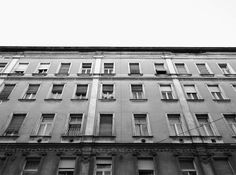 Hundreds of windows, hundreds of stories #old #white #house #budapest #black #stories #building #and #windows
