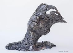 Human Figures Composed of Unraveling Stainless Steel Ribbons by Gil Bruvel