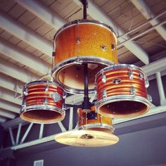 A restaurant light fixture made out of an old drum set.