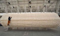 A Suspended Boat of 8,000 Sheets of Rice Paper Draped on Bamboo by Zhu Jinshi #tube #installation
